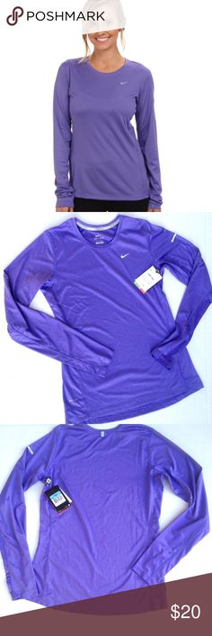 """NWT Nike dri-fit long sleeve Miler top Women's Medium Nike dri fit long sleeve Miler top in """"Purple Haze"""" with silver reflective swoosh on front, dri fit logo and visibility tag on back. SPF 40 protection. Loose fit style. Chest measures 36"""". 25"""" length. Nike Tops Tees - Long Sleeve"""