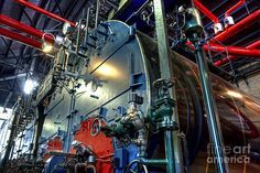 Woudagemaal Steam. Photograph.  Woudagemaal steam.  Steam boilers, valves and pipes of water pumping station.  The ir. D.F. Woudagemaal the largest still operational steam-powered pumping station in the world. It is used to pump excess water out of Friesland, a province in the north of the Netherlands. ir. D.F. Woudagemaal has been listed on the UNESCO World Heritage Site list.