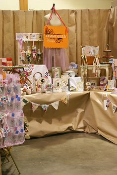 neutral backdrop/table cloth (paper?) = merchandise pops more