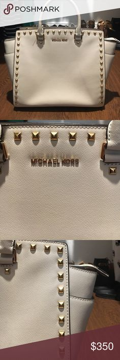 Michael Kors Handbag Michael Kors White Handbag. Gorgeous statement Purse! Gold Stud detailing. Detachable strap. No defects. Only used twice. Like brand new! ACCEPT REASONABLE OFFERS Michael Kors Bags Shoulder Bags