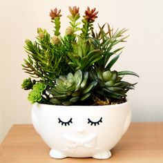 Repurpose Easter decor with some spray paint and vinyl for a fun and fresh looking planter!