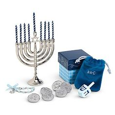 """American Girl HANUKKAH GIFT SET w Chanukah MENORAH & MORE For 18"""" DOLL (2007) by American Girl, Mattel. $58.99. A Beautiful Hanukkah Gift Set for any 18"""" Doll. Set comes with a silver tone Menorah that's approx. 4"""" tall & 3"""" wide, 9 dark blue w/diagonal stripe Candles (pretend) each Candle approx. 1-3/8"""" long, 6 COINS (Coins are called Hanukkah """"Gelt"""" which is Money given as a Gift during Chanukah), a Dreidel that's a Game children & adults play (Spin the Dreidel is the..."""