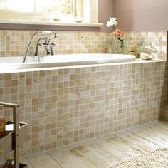 Natural travertine stone is cut into tiles before being tumbled to soften the surfaces and edges, producing a more rustic appearance.