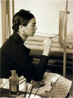 "Frida Kahlo painting ""Self-Portrait on the Borderline Between Mexico and the United States in the Detroit Institute of Arts mural project studio, 1932."