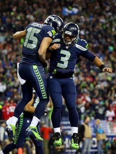 Seattle Seahawks Team Photos - ESPN. Jermaine Kearse (15) and Russell Wilson (3).