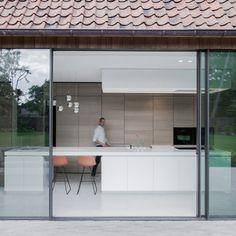 Contekst combines oak, stone and concrete inside a minimal Belgian house