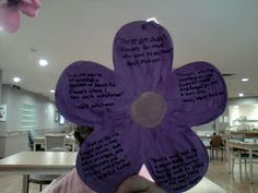 I painted this wooden wall hanging of a flower with two shades of purple, blended and a light coating of daffodil yellow for the center.  Then I printed quotes about flowers in each petal