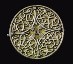 """artofthedarkages: """" Six disk brooches with dense interlace, animal motif, and christian openwork designs. Crafted out of silver, with niello details. Made in the for an Saxon nobleman in East. Medieval Jewelry, Viking Jewelry, Ancient Jewelry, Medieval Art, Viking Culture, Early Middle Ages, Ancient Vikings, Viking Age, Celtic Art"""