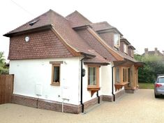 Extensions and alterations to a chalet bungalow, Puttenham, Surrey - Portfolio Bungalow Conversion, Bungalow Renovation, Bay Window, Surrey, Extensions, Shed, Lounge, Cottage, Outdoor Structures