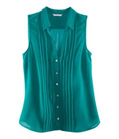 Wear sleeveless semi-sheer top, only middle-buttoned to create V's, over tank and skirt or pants.