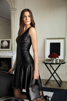 This luxe Lauren Ralph Lauren sleeveless dress is crafted from smooth leather and features a sharp V-neckline.