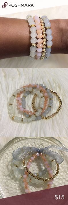 Colorful Bracelet! 4 piece layered crystal beaded bracelet. Colors are pink, white, gold and light blue! Jewelry Box Jewelry Bracelets