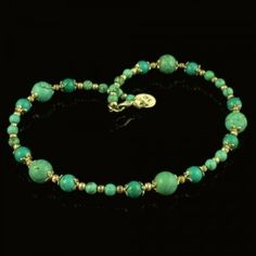 Turquoise Beads Choker style necklace decorated with Tibetan Silver Beads.
