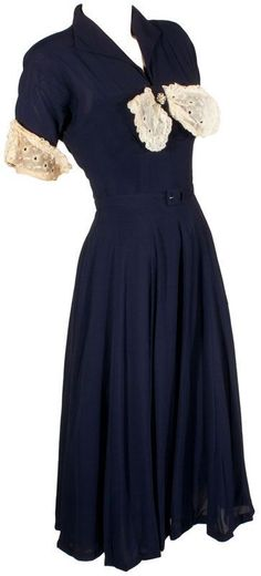 Vintage 1940s Swing Dress at ballyhoovintage.com Women's vintage fashion clothing outfit for fall #vintageclothing