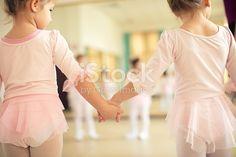 Group of little girl ballerinas on ballet class in dance studio practicing in front of mirror