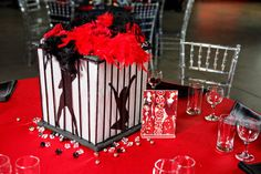 Broadway Themed Wedding: Chicago centerpiece each table would be musical inspired.
