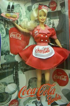In Jean Wardlaw's showcase, she features these  Coca-Cola Barbies