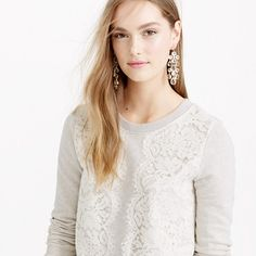 "Proof that sweatshirts <i>can</i> be pretty, thanks to a touch of feminine lace. <ul><li>Slightly loose fit.</li><li>Body length: 23"".</li><li>Cotton.</li><li>Long sleeves.</li><li>Import.</li></ul>"