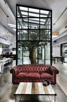 This rustic yet contemporary restaurant by Noses Architects is a 2012 project located in Lazio, Italy.  It is a reinterpretation of the traditional tavern and pizzeria.    Kook by Noses Architects | HomeDSGN, a daily source for inspiration and fresh ideas on interior design and home decoration.