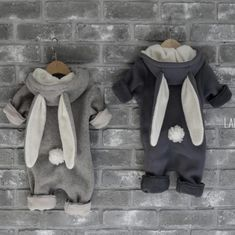 A new Winter style of our popular bunny onesie for babies & toddlers, featuring a zip at the front for easy diapering. Soft zip flap protecting the most delicate baby skin. Perfect as an additional outer layer or for lounging. Also available in light grey 100% Thick cotton fleece with a detachable tail Fits true to size with plenty of growing room 0-6 months / XS: 58cm in length (shoulder to hem) 6-12 months / S: 64cm in length (shoulder to hem) 12-18 months / M: 67cm in length (shoulder to…