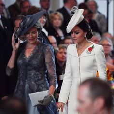 Kate Middleton Photos Photos - Catherine, Duchess of Cambridge talks with Queen Mathilde of Belgium as they attend commemorations marking the centenary of Passchendale in the town market square on July 30, 2017 in Ypres, Belgium.