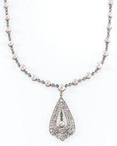 From blog post: Edwardian Platinum, Seed Pearl and Diamond Pendant-Necklace. Removable Medallion Drop. Circa 1900 (www.jsfearnley.com)