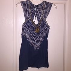 Unique Blue Boho Top Navy blue top, elastic waist and bottom flare, with beading detail and open back. Purchased from boutique, worn once. Tops Blouses