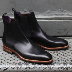 Black calfskin Chelsea boot, natural welt and sole edge. Dainite (?) sole. Purple interior.