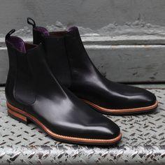 Black calfskin Chelsea boot, natural welt and sole edge. Dainite (?) sole. Purple interior.