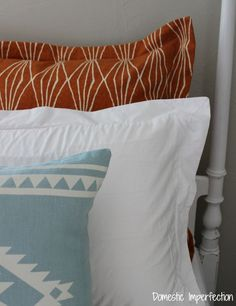 Today I have a simple tutorial to share... A couple of weeks ago I showed you the new bedding for my southwestern guest room, and today I'm going to show you how to make the euro sham pillows. (Th...