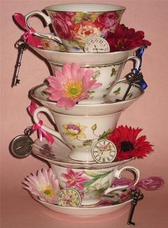 Would be cute with solid color tea cups Alice in Wonderland Inspired Stacked Teacup Centerpiece - Victorian styled teacups & saucers - For a Mad Hatter Tea Party, Wedding or Shower