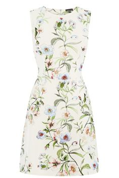 This sleeveless dress is constructed from a neoprene fabric and features a round neck, nipped in waist, A-line skirt, all-over floral print and exposed zip fastening at the nape. Length of dress, from shoulder seam to hem, 89cm approx. Height of model shown: 6ft/183cm. Model wears: UK size 10.Fabric: Main: 93.0% Polyester