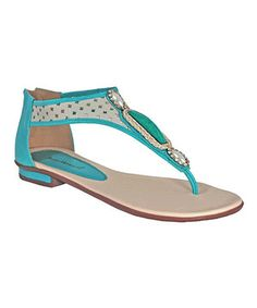 Sunny days look oh-so chic with these stylish sandals. The back zipper slides down to let fashionable feet enter without effort, while the perforated strap and charm details give this pair an irresistible touch of feminine fashion.