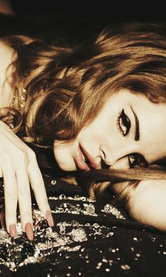 """Femme fatale, always on the run, diamonds on my wrist, whiskey on my tongue."" Lana Del Rey"