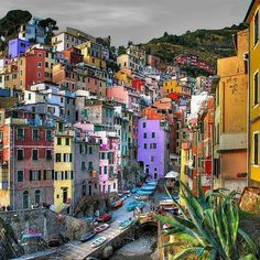 "ITALY-This is the town of Riomaggiore in the so called ""Cinque Terre"" in north-west Italy. About 70 Km south of Genua and 30 Km west of La Spezia. In La Spezia in World War 2 german submarine boats were located. This harbor had been used as a base for the german army fighting in Africa ."