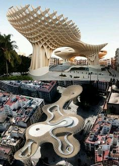 The Metropol Parasol in Seville, Spain, by Jurgen Mayer H. Architects, is the world's largest wooden structure. The views of Sevilla were gorgeous. And there are Roman ruins underneath! Architecture Unique, Futuristic Architecture, Landscape Architecture, Canopy Architecture, Unusual Buildings, Amazing Buildings, Cadiz, Seville, Places