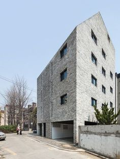 Beyond the Screen apartment block in Seoul, South Korea, with open brickwork stairwell by OBBA. Cabinet D Architecture, Facade Architecture, Contemporary Architecture, Screened Porch Decorating, Screened In Porch, Sliding Screen Doors, Archi Design, Residential Complex, Screen Design