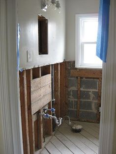 Bathroom remodel (includes info on replacing rotten floor planks, installing new joists, laying down plywood subflooring)