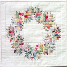 "Create a lovely 14 1/2"" square quilt with this paper foundation pieced pattern. Using 9 different floral fabrics, this Floral Wreath is one way to bring your garden indoors! Designed by Mary Herschleb"