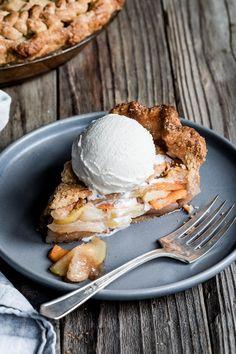 Vanilla bean pear persimmon pie with a buttery flakey vanilla gluten-free pie crust