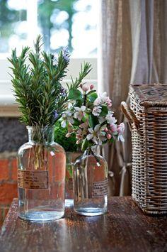 Simple and elegant - blooms and herbs in vintage medical vessels