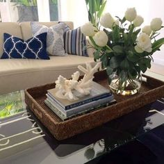 Simple styling on the coffee table. Nothing more needed... And the cushions