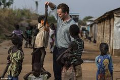 Good deed: He was spotted in a number of heart-warming pictures where he interacted with t...