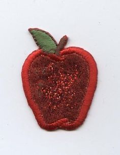 """Glittery Single Red Apple Iron on Applique High quality, detailed embroidery applique. Can be sewn or ironed on. Great for hats, bags, clothing, and more! Size is approx. 1"""" x 1-1/2"""" or 2.54cm x 3.81c"""