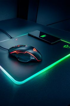 RGB LED illuminated mousepad with built-in wireless charger for smartphones Pc Gamer, Gamer Room, Computer Gaming Room, Gaming Room Setup, Apple Logo Wallpaper Iphone, Latest Cell Phones, Video Game Rooms, Game Room Design, Gaming Accessories