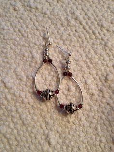 Silver and garnet earrings.