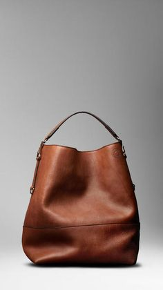 Burberry - Large Washed Leather Duffle Bag in supple washed leather. Open top with parrot clasp. Single flat leather handle attached with D-rings. Purse pocket with leather zip pull and multiple interior pouch pockets.
