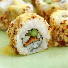 Bacon, blue crab, and asparagus inside-out roll crusted in toasted almonds and covered with a lemongrass hollandaise.