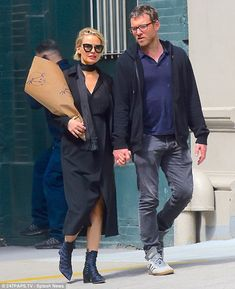 Something to hide? Lara Bingle made sure she kept any potential baby bumps underwraps as s...