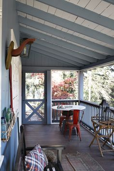 PS: Do you have a favorite space in the cottage? DS: Hands down, the screened front porch. When it rains, you can sit out there and listen to the rain coming down with a blanket and a glass of wine — it's heavenly. Photo by Armando Rafael Photography House, Home, Cottage Porch, Rustic Pergola, House Exterior, Porch Design, Porch Life, Screened Porch Designs, Cabin Porches